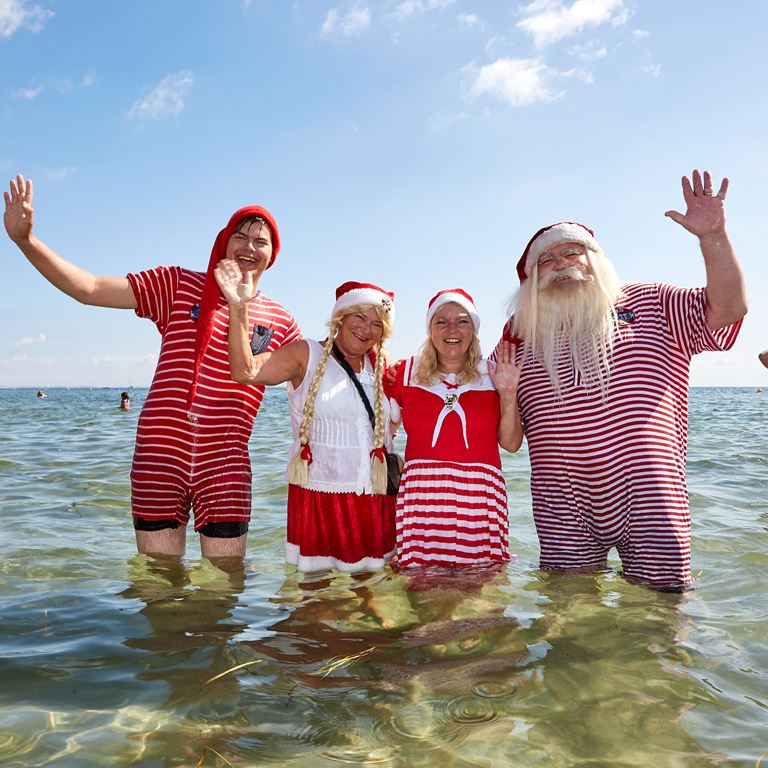 Santas from all around the world meet for their annual footbath at Bellevue Beach during World Santa Claus Congress 2020 at Bakken